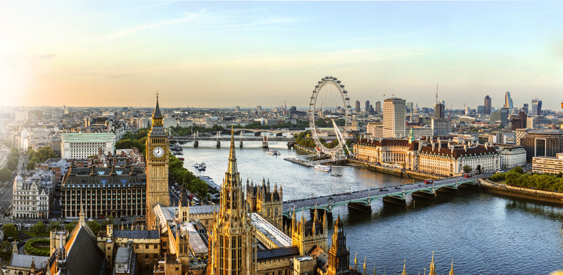 The view from Victoria Tower of the Houses of Parliament, the River Thames, Westminster and Westminster Bridge, to the Millennium Wheel and other landmarks in the evening as the light fades.
